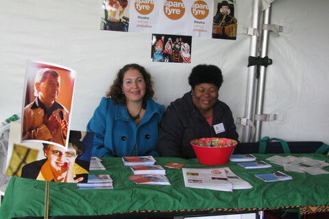 A photo of two members of inc.Theatre at a stall