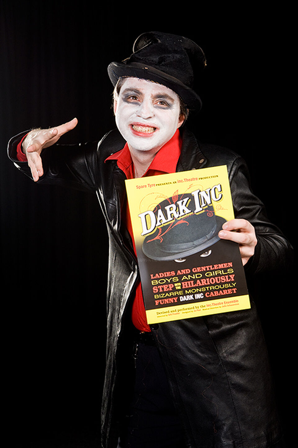 "A photo of an actor during a performance of ""Dark Inc"""
