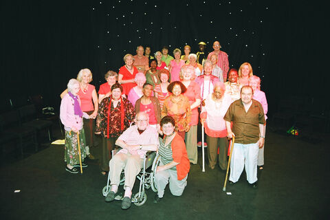 "Group photo of ""What's in it For Me?"" performers on stage"