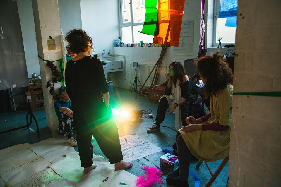 Three artist work in a rehearsal room