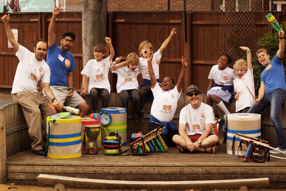 The Spare Tyre band with primary school children